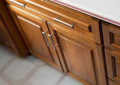 Colonial-Bronze-Pulls-on-Cabinet